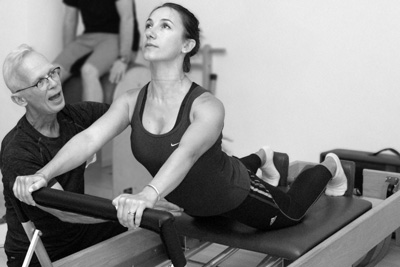Zhivka Yaneva stretch exercise on the reformer in the Palma Pilates Studio in The Hague