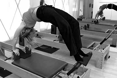 Catarina Palma on the reformer in the Pilates Studio Palma Personal Training Den Haag
